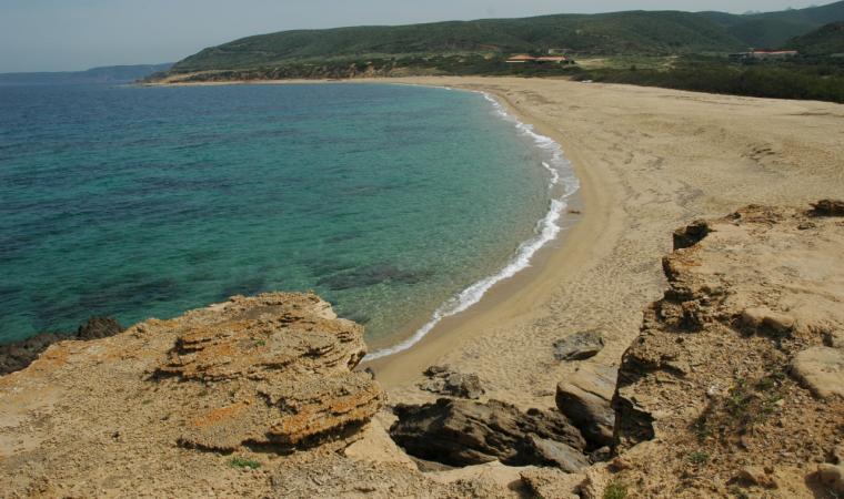 Bagnante nelle acque cristalline di Portu Maga; Beach of Portu Maga
